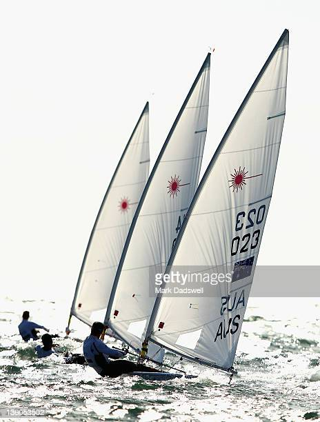 Ashley Brunning of Australia chases two competitors in the Laser Men's One Person Dinghy Medal race on the Centre Course during day 16 of the ISAF...