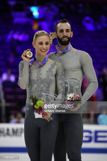 Ashley Cain and Timothy LeDuc hold up their gold medals after winning the pairs competition at the 2019 US Figure Skating Championships at Little...