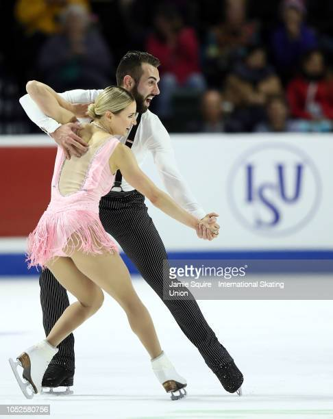 Ashley Cain and Timothy Leduc of the United States compete in the Pairs Short Program during the ISU Grand Prix of Figure Skating Skate America on...