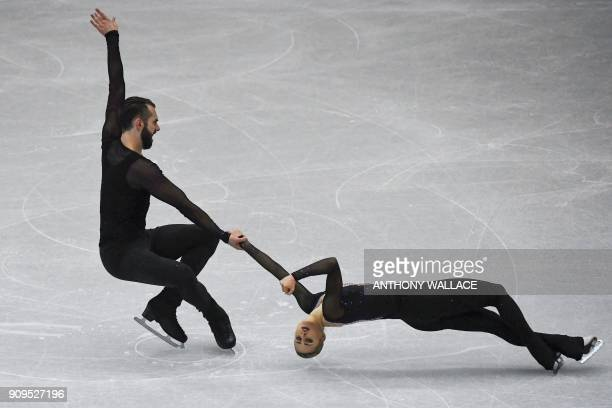 Ashley Cain and Timothy Leduc of the US perform during the pairs short program at the ISU Four Continents figure skating championships in Taipei on...