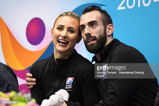 Ashley Cain and Timothy Leduc of the USA celebrate at kiss and cry afer the pairs short program during the Four Continents Figure Skating...