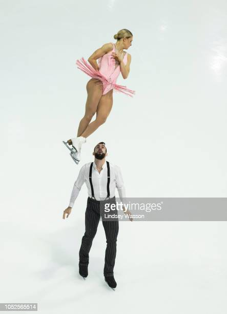 Ashley Cain and Timothy Leduc of the USA perform in the Pairs Short Program during the ISU Grand Prix of Figure Skating Skate America at Angel of the...