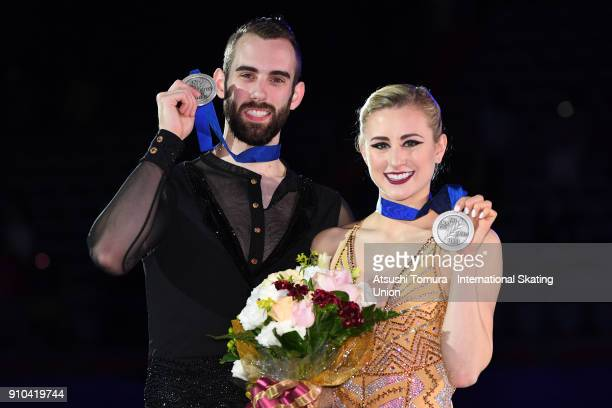 Ashley Cain and Timothy Leduc of the USA pose with their silver medals for the pairs free skating during day three of the Four Continents Figure...
