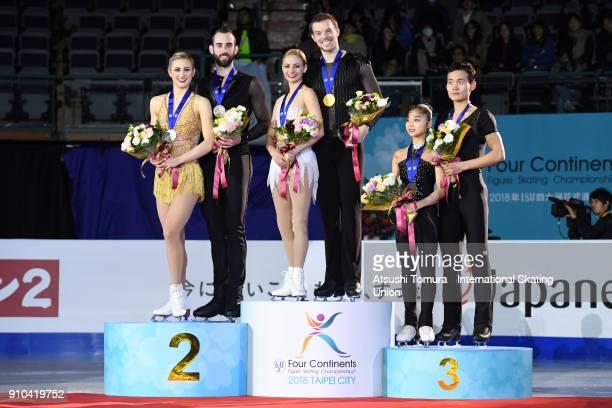 Ashley Cain and Timothy Leduc of the USA Tarah Kayne and Danny O'Shea of the USA Tae Ok Ryom and Ju Sik Kim of North Korea pose with their smedals...
