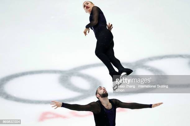 Ashley Cain and Timothy Leduc of United States compete in the Pairs Short Program on day one of Audi Cup of China ISU Grand Prix of Figure Skating...