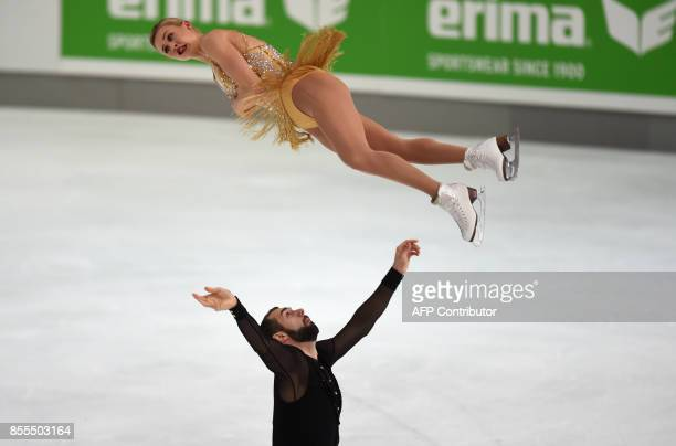 Ashley Cain and Timothy Leduc of USA perform during their pairs free skating program of the 49th Nebelhorn trophy figure skating competition in...