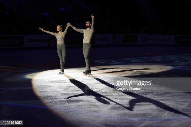 Ashley Cain and Timothy LeDuc react after being announced as the gold medal winners at the pairs competition at the 2019 US Figure Skating...