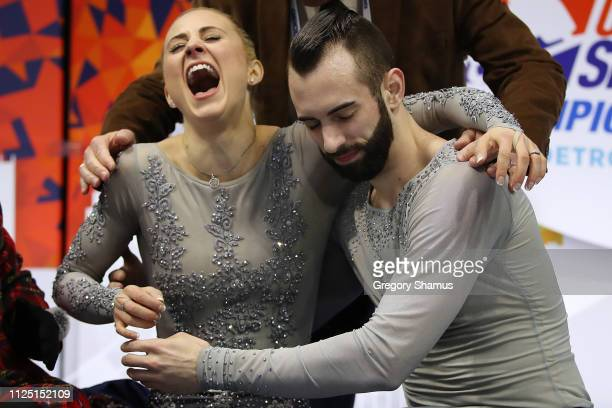 Ashley Cain and Timothy LeDuc react after their score is posted from their senior pairs free skate to win the gold medal at the 2019 US Figure...