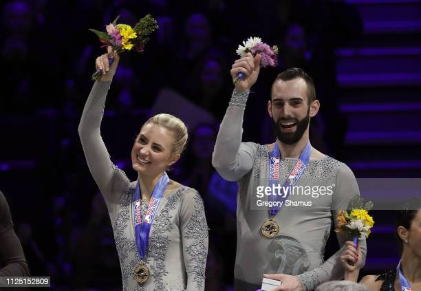 Ashley Cain and Timothy LeDuc react on the podium after winning the pairs competition at the 2019 US Figure Skating Championships at Little Caesars...