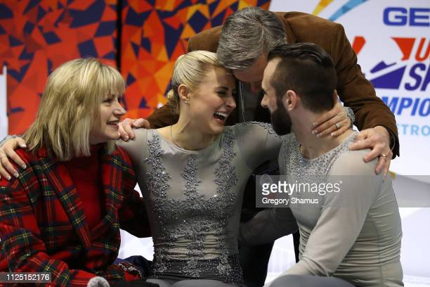 Ashley Cain and Timothy LeDuc react with their coaches after their score is posted from their senior pairs free skate to win the gold medal at the...