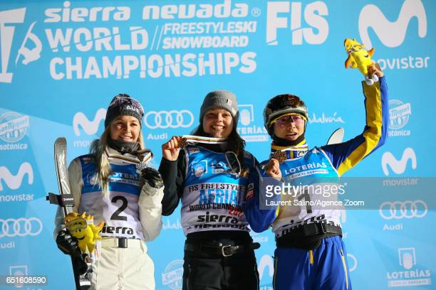 Ashley Caldwell of USA wins the gold medal Danielle Scott of Australia wins the silver medal Mengtao Xu of China wins the bronze medal during the FIS...