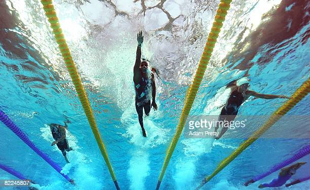 Ashley Callus of Australia Cullen Jones of the United States and Frederick Bousquet of France compete in the 3rd leg of the Men's 4 x 100m Freestyle...