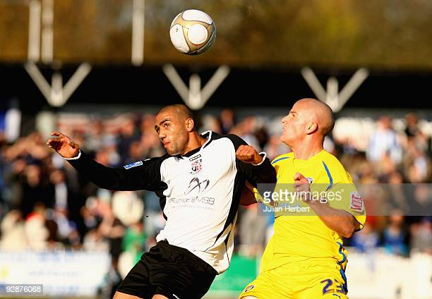Ashley Carew of Bromley beats Mark Tierney of Colchester United to the ball during the FA Cup 1st Round Proper match between Bromley and Colchester...