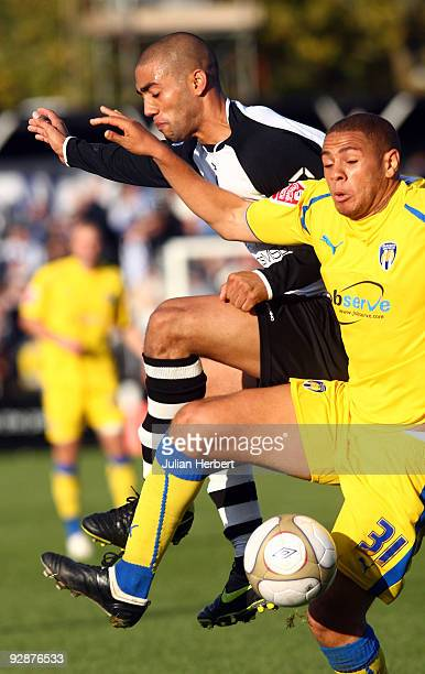 Ashley Carew of Bromley tangles with Phil Ifil of Colchester United during the FA Cup 1st Round Proper match between Bromley and Colchester United at...