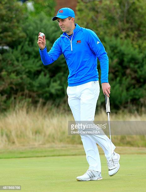 Ashley Chesters of Great Britain and Ireland acknowledges the crowd after holing a putt on the 14th hole in the morning fousomes matches in the 2015...