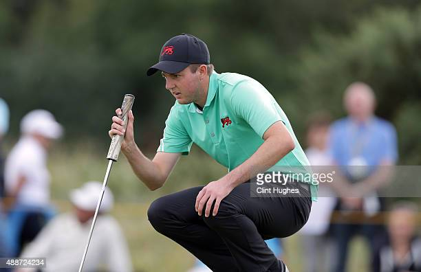 Ashley Chesters of Great Britain and Ireland Walker Cup Team lines up a putt shot during his afternoon singles match during day two of the 2015...