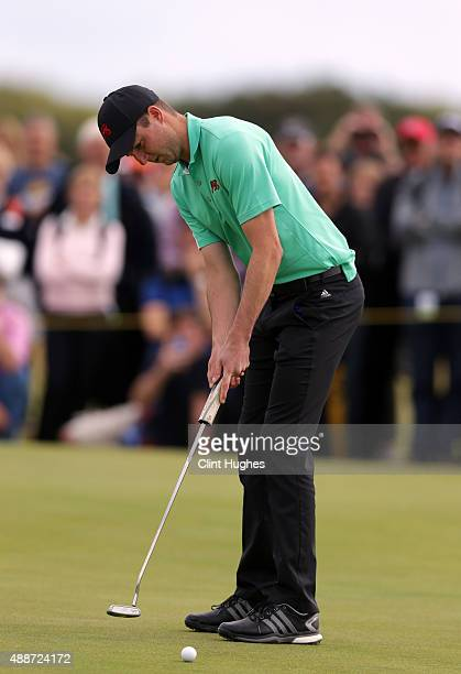 Ashley Chesters of Great Britain and Ireland Walker Cup Team plays a putt shot during his afternoon singles match during day two of the 2015 Walker...