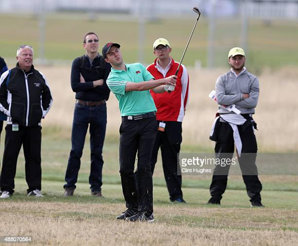 Ashley Chesters of Great Britain and Ireland Walker Cup Team plays an approach shot during his afternoon singles match during day two of the 2015...