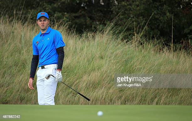 Ashley Chesters of Great Britain Ireland watches his ball during the Saturday Singles on Day One of the 2015 Walker Cup at Royal Lytham St Annes on...