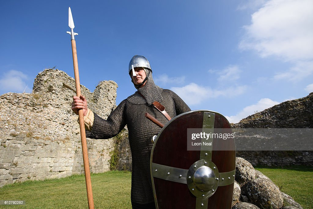 Ashley Clark of Whitstable poses in his Norman armour costume before speaking to schoolchildren in Pevensey Castle on October 4, 2016 in Pevensey, England. With the 950th anniversary of 1066, the Battle of Hastings and the Norman Conquest approaching, English Heritage, local groups and businesses are preparing to mark the historic invasion with re-enactments, tours and concerts.