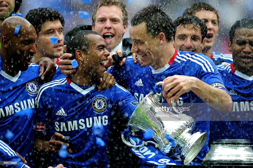 Ashley Cole (L) and John Terry of Chelsea lead the celebrations after winning the FA Cup sponsored by E.ON Final match between Chelsea and Portsmouth at Wembley Stadium on May 15, 2010 in London, England.