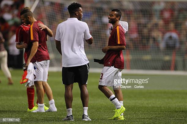 Ashley Cole AS Roma talks with Daniel Sturridge Liverpool after the Liverpool Vs AS Roma friendly pre season football match at Fenway Park Boston USA...