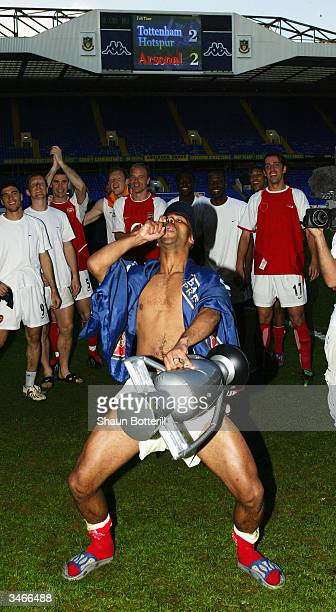 Ashley Cole of Arsenal celebrates at the end of the FA Barclaycard Premiership match between Tottenham Hotspur and Arsenal at White Hart Lane on...