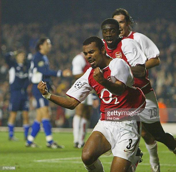 Ashley Cole of Arsenal celebrates with his teammates after scoring the first goal for Arsenal during the UEFA Champions League First Stage Group B...