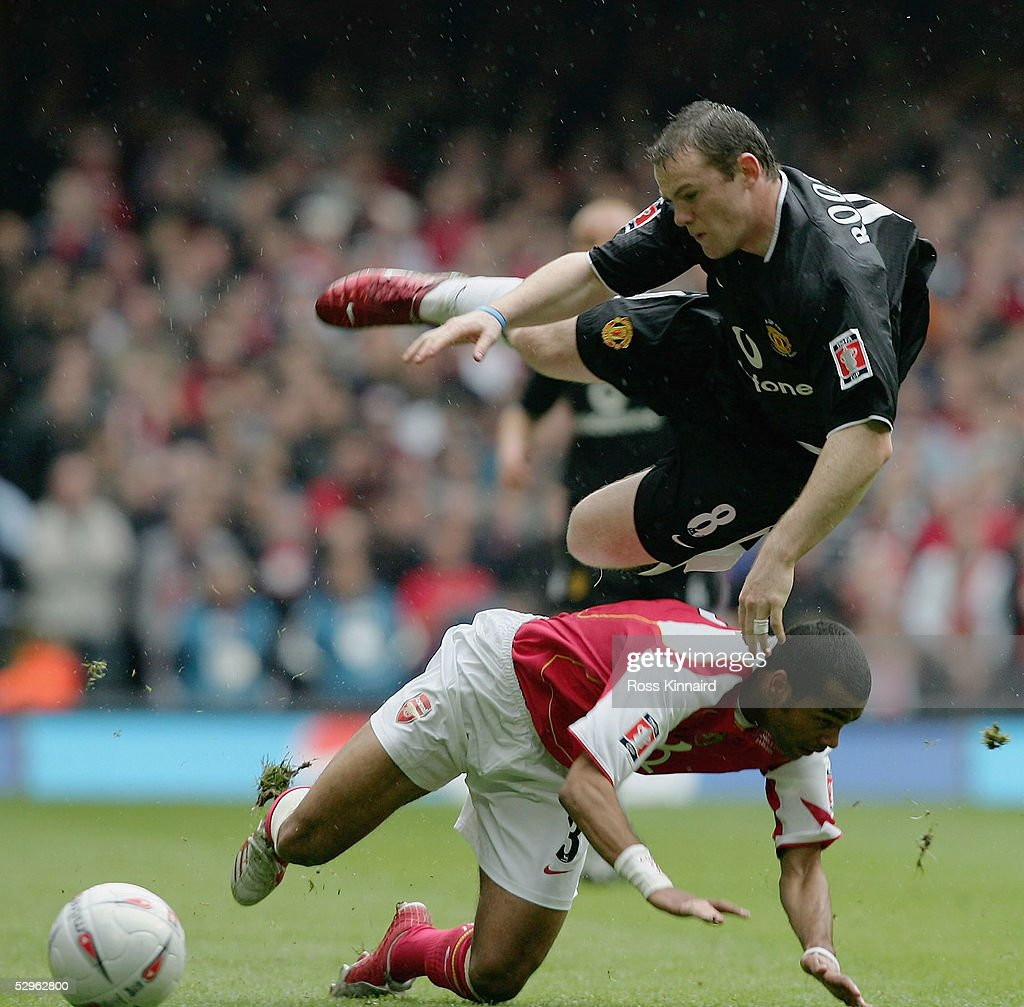 Ashley Cole of Arsenal fouls Wayne Rooney of Manchester United during the FA Cup Final between Arsenal and Manchester United at The Millennium Stadium on May 21, 2005 in Cardiff, Wales.