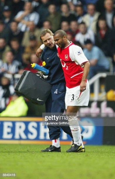Ashley Cole of Arsenal goes off injured during the FA Barclaycard Premiership match between Newcastle United and Arsenal at St James Park on April 11...