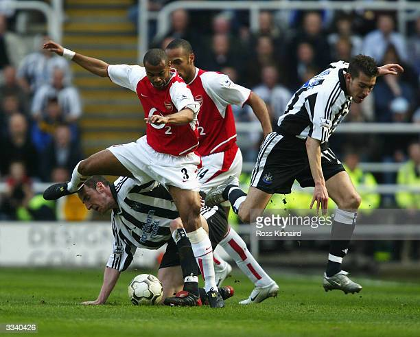 Ashley Cole of Arsenal holds off Andy O'Brien of Newcastle during the FA Barclaycard Premiership match between Newcastle United and Arsenal at St...