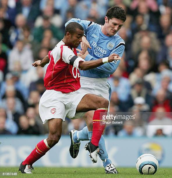Ashley Cole of Arsenal is challenged by Jon Macken of Manchester City during the Barclays Premiership match between Manchester City and Arsenal at...