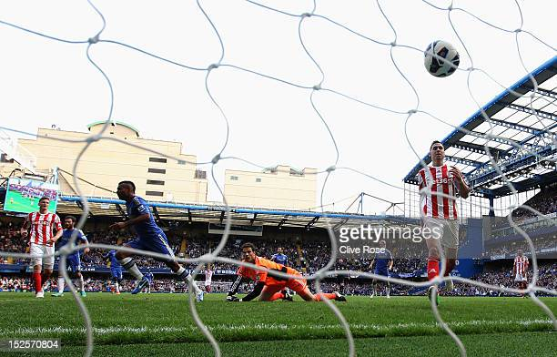 Ashley Cole of Chelsea celebrates as he beats goalkeeper Asmir Begovic of Stoke City to score their first goal during the Barclays Premier League...