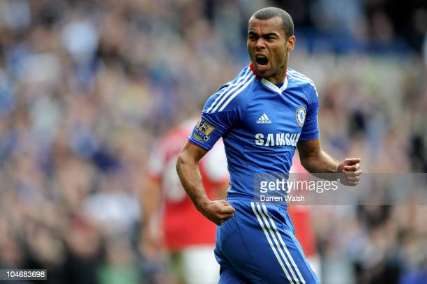 Ashley Cole of Chelsea celebrates their first goal scored by Dider Drogba during the Barclays Premier League match between Chelsea and Arsenal at...
