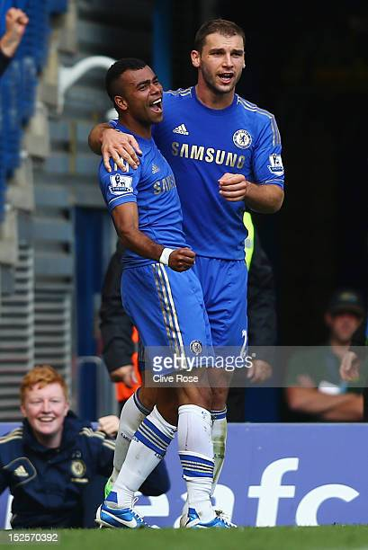Ashley Cole of Chelsea celebrates with Branislav Ivanovic as he scores their first goal during the Barclays Premier League match between Chelsea and...