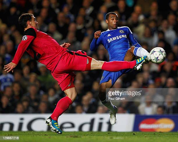 Ashley Cole of Chelsea challenges Abel Masuero of Genk during the UEFA Champions League group E match between Chelsea and Genk at Stamford Bridge on...
