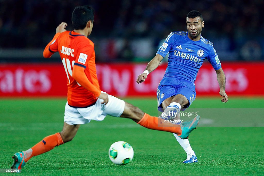 Ashley Cole (R) of Chelsea challenges Jesus Corona (L) of CF Monterrey during the FIFA Club World Cup Semi Final match between CF Monterrey and Chelsea at International Stadium Yokohama on December 13, 2012 in Yokohama, Japan.