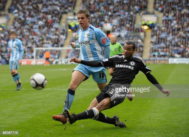 Ashley Cole of Chelsea crosses the ball ahead of Jordan Henderson of Coventry City during the FA Cup Sponsored by E.ON 6th Round match between...
