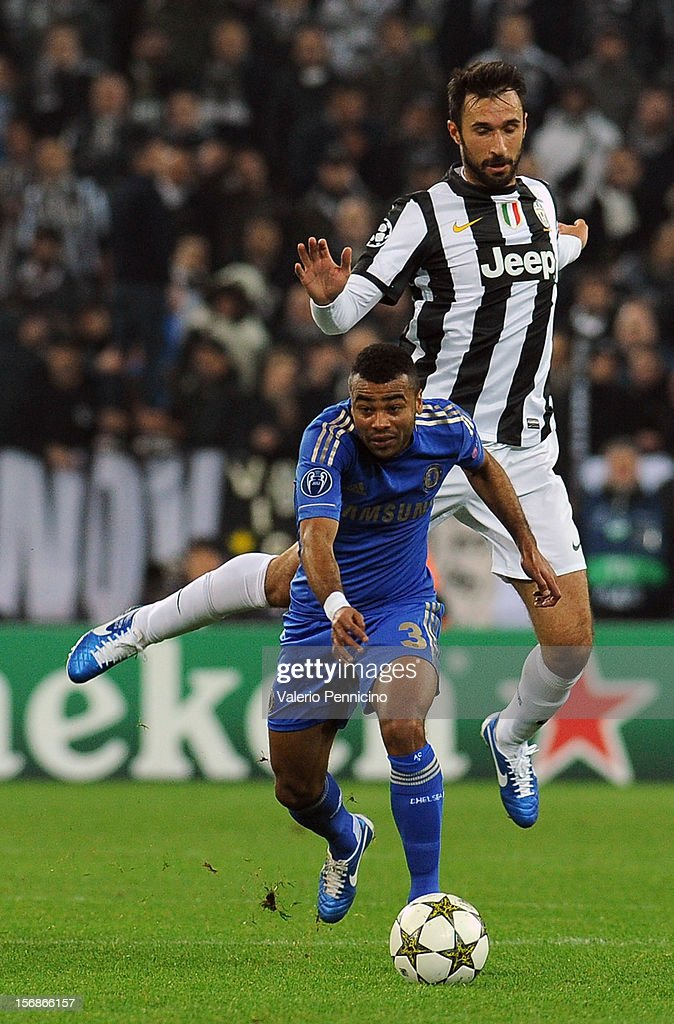 Ashley Cole of Chelsea FC is challenged by Mirko Vucinic of Juventus during the UEFA Champions League Group E match between Juventus and Chelsea FC at Juventus Arena on November 20, 2012 in Turin, Italy.