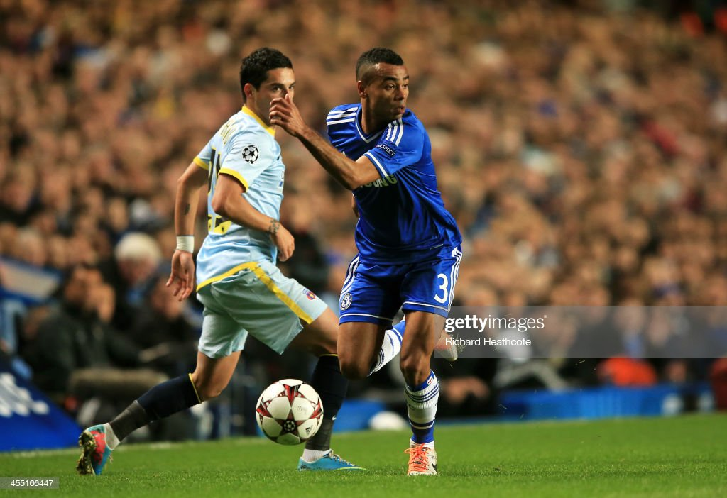 Ashley Cole of Chelsea goes past Nicolae Stanciu of Steaua during the UEFA Champions League Group E match between Chelsea and FC Steaua Bucuresti at Stamford Bridge on December 11, 2013 in London, England.