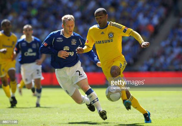 Ashley Cole of Chelsea is challenged by Tony Hibbert of Everton during the FA Cup sponsored by EON Final match between Chelsea and Everton at Wembley...