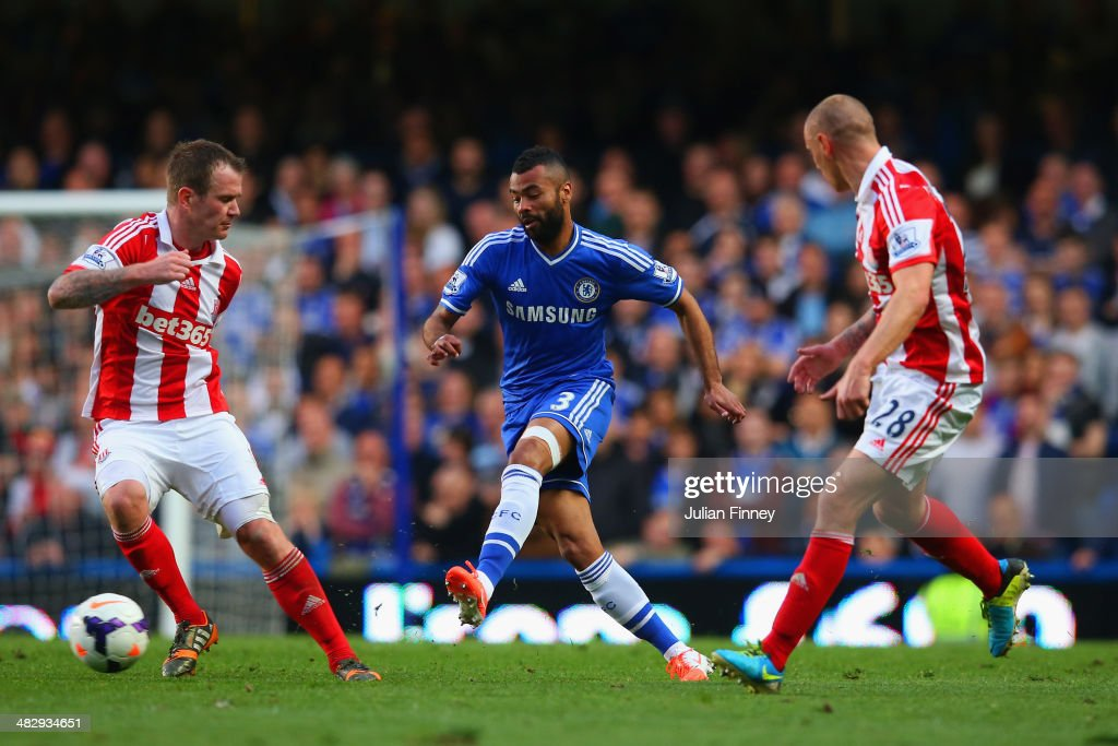 Ashley Cole of Chelsea is closed down by Charlie Adam of Stoke City and Andy Wilkinson of Stoke City during the Barclays Premier League match between Chelsea and Stoke City at Stamford Bridge on April 5, 2014 in London, England.