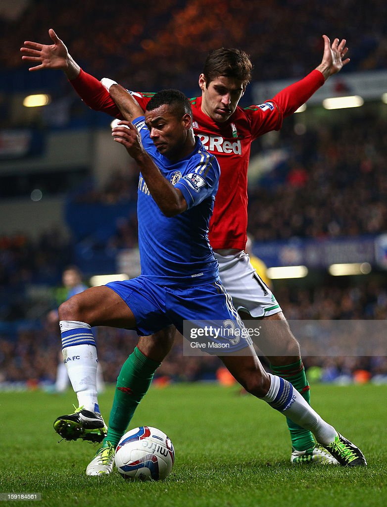 Ashley Cole of Chelsea is closed down by Danny Graham of Swansea City during the Capital One Cup Semi-Final first leg match between Chelsea and Swansea City at Stamford Bridge on January 9, 2013 in London, England.