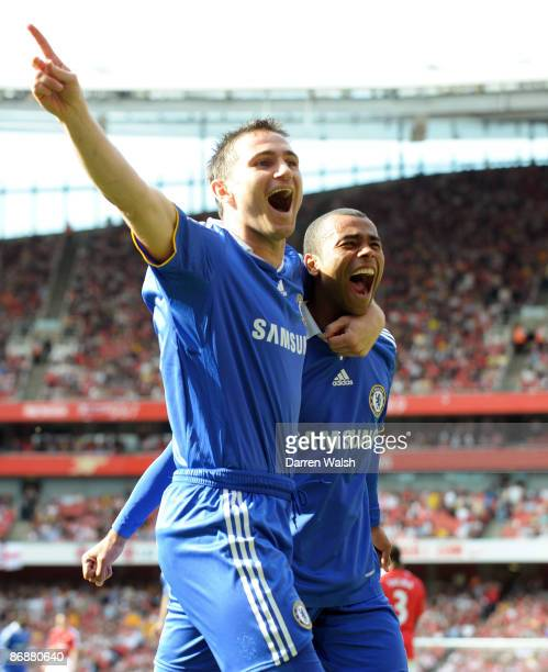 Ashley Cole of Chelsea is congratulated by team mate Frank Lampard after his shot was deflected in by Kolo Toure of Arsenal for the third goal of the...