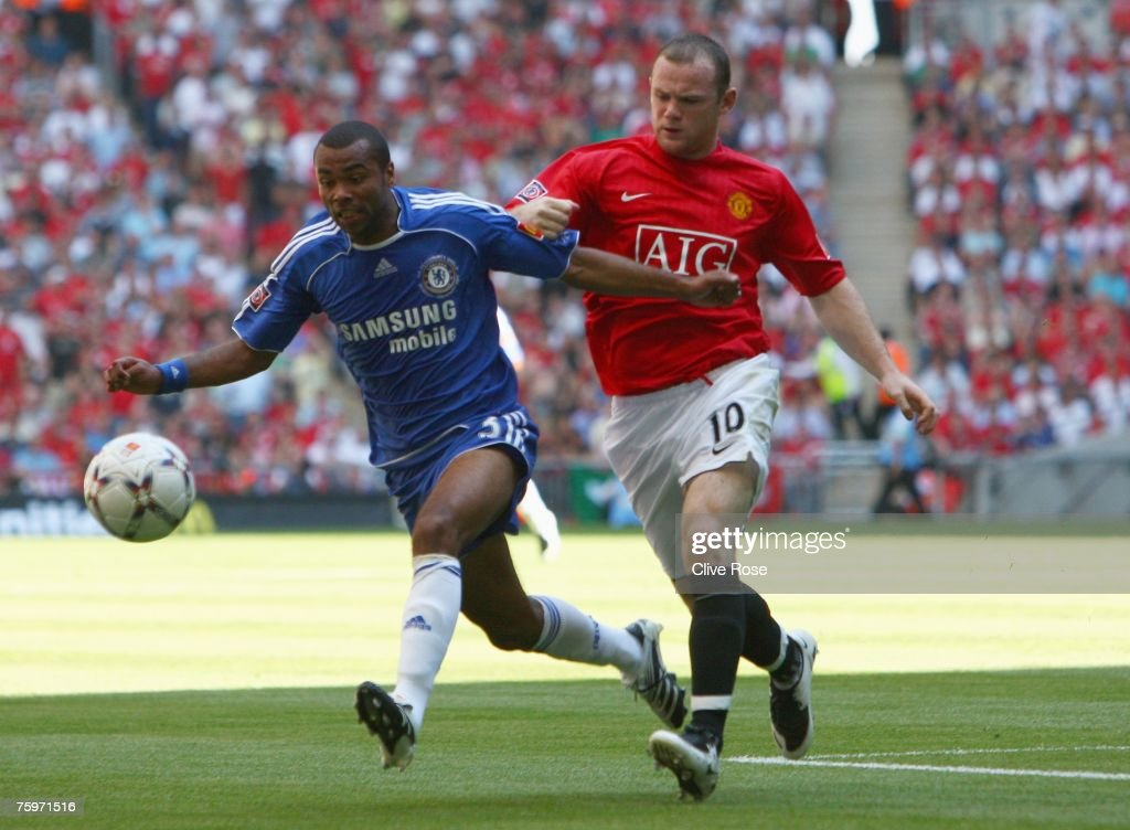 Ashley Cole of Chelsea is pushed by Wayne Rooney of Manchester United during the FA Community Shield match between Chelsea and Manchester United at Wembley Stadium on August 5, 2007 in London,England.