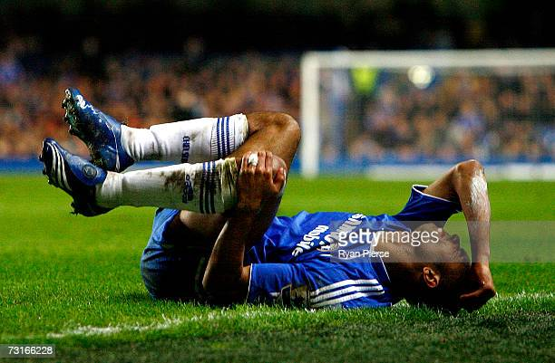Ashley Cole of Chelsea reacts on the ground after he got injured during the Barclays Premiership match between Chelsea and Blackburn Rovers at...