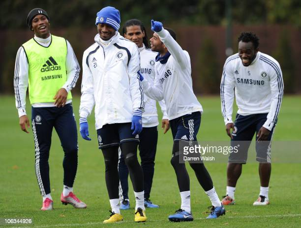 Ashley Cole of Chelsea tells Salomon Kalou to leave the shooting competition during a training session at the Cobham training ground on October 29...