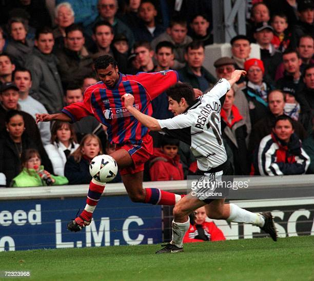 Ashley Cole of Crystal Palace and Paul Peschisolido of Fulham in action during the match between Fulham v Crystal Palace in the Nationwide League...
