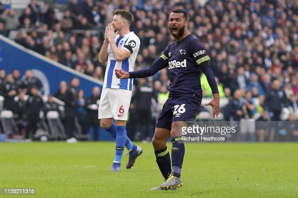 Ashley Cole of Derby County celebrates after scoring his team's first goal as Dale Stephens of Brighton and Hove Albion reacts during the FA Cup...