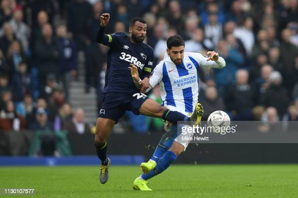 Ashley Cole of Derby County challenges Alireza Jahanbakhsh of Brighton Hove Albion during the FA Cup Fifth Round match between Brighton and Hove...